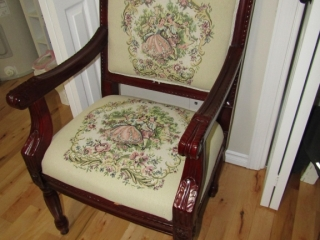 Arm chair with upholstered seat and back