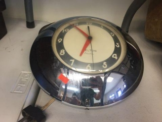 "Kelton electric clock. 10"" diameter"