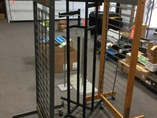 "Two 2-sided grid display stands on wheels 67"" tall"