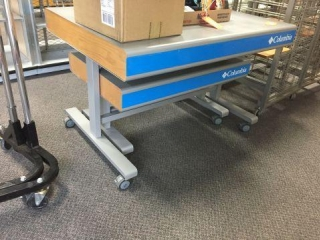 2 Columbia tables on wheels 48x36x31, 40x28x22