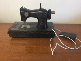 Plastic singer sewing machine.