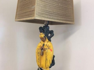 "Figural lamp with shade. 28"" tall"