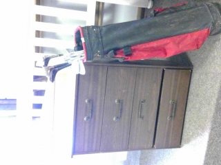 4 drawer dresser with Various  Golf clubs