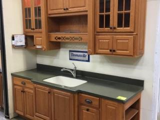 Thomasville Langston kitchen cabinets, oak with Corian countertop