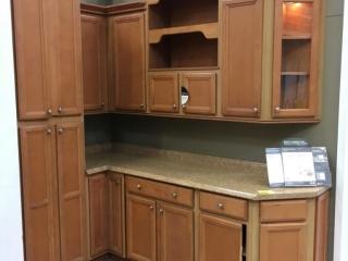American Woodmark Ashland maple kitchen cabinet with laminated countertop