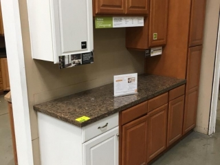 Mis-matched kitchen cabinets with granite countertop