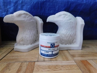 PAIR OF EAGLE HEAD BOOKENDS AND TUB OF CLEAR CLAY