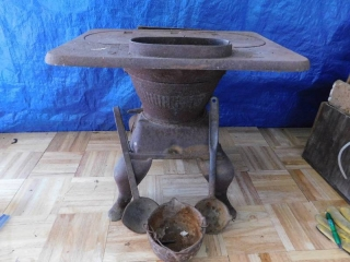 SMALL CAST IRON STOVE WITH SMELTING LADLES