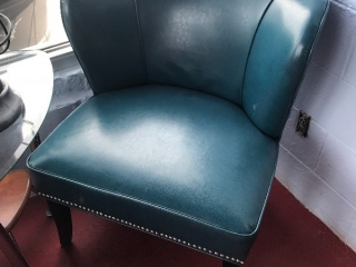 Teal leather-style chair