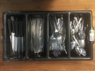 Silverware tray with steak knives, forks and spoons