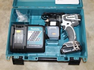 Makita 18V battery powered drill w/ charger and extra battery Unused
