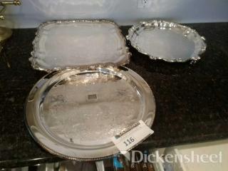 Silver tone serving platters as photographed.