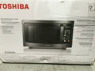 Toshiba 1.2 Cu. Ft. Microwave Oven in Black Stainless Steel not used