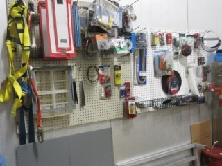 Lot of Assorted Parts on Peg Board Including