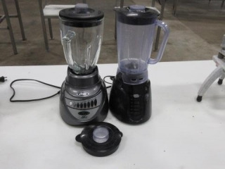 (2) Oster Blenders with an Extra Lid