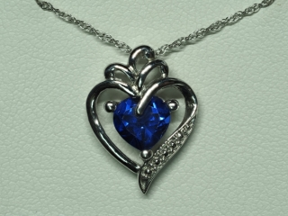 Sterling Silver Created Sapphire Pendant With Chai