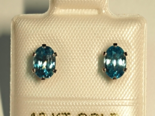 $140 10K Blue Topaz Earrings