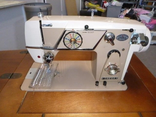 OMEGA SEWING MACHINE IN TABLE