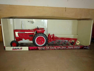 Farmall 706 tractor with plow, dealer edition by