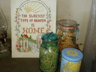 Embroidery picture, jars of pasta