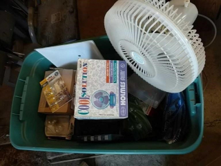 Tote of fans and light bulbs