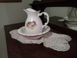 Floral bowl and pitcher set with doilie