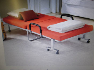 Folding bed in red
