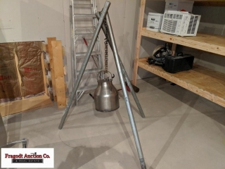 Over the fire, pressure cooker with tripod. Item .
