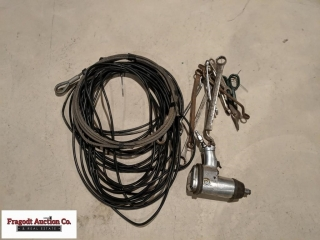 Misc cable, wrenches, and air impact. Item is loc.