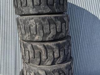 (4) 12-16.5 skidloader tires, tread is poor. Item