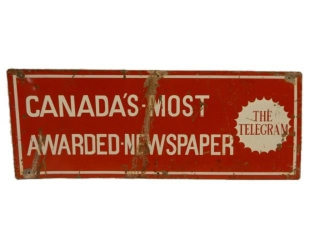 "THE TELEGRAM ""MOST AWARDED NEWSPAPER"" SST SIGN"
