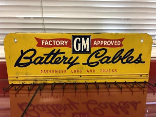 Vintage GM Battery Cables rack sign from the 1930s