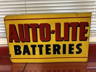 Auto-lite Batteries painted tin flange sign