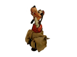 1950'S DISNEY GOOFY ON WIND-UP UNICYCLE