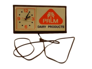 1960'S PALM DAIRY PRODUCTS ELECTRIC CLOCK