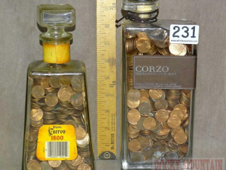 2 Full Bottles of Pennies.