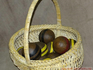 Basket W/ Assorted Color Croquet Balls.