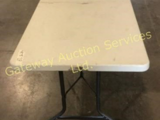 Plastic Folding Table. 6 ft L 36 in W