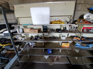 Storage shelf, trailer hitches, contents