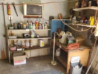 Motor oil, shop brushes, scrap metal, workbench