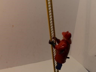 Climbing Fireman tin windup toy (working)