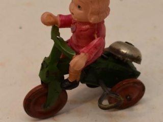 Windup Girl on a tricycle working