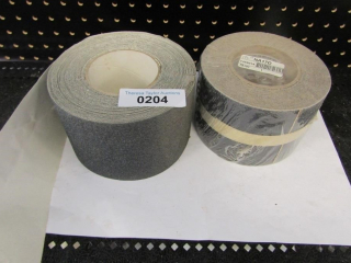 Sandpaper-like grit surface with adhesive back.
