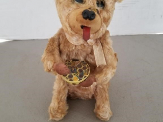 Vintage Wind-Up Toy Bear Eating Honey