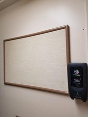 corkboard and motion activated sanitizer