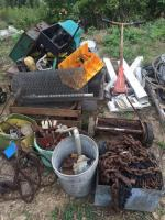 Pallet of miscellaneous items- chicken wire- baskets-hardware-bins-camp stove-Scott's push mower- logging chain- etc.
