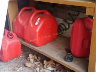 4 gas cans located bottom shelf right hand side