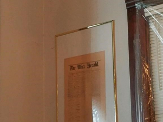 large framed copy of old edition of utica herald