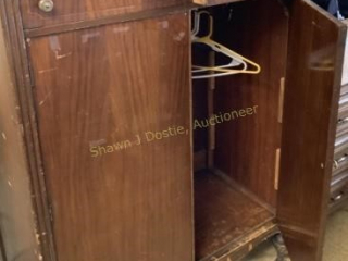 Wooden armoire with two drawers on top location