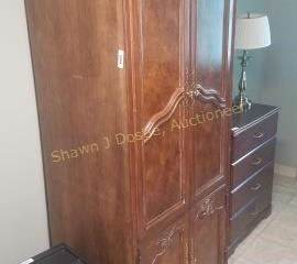 7 foot wooden armoire with an inlay look room